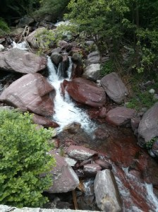 Waterfall over rust-coloured granite