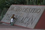 Nadia and Alex finger tracing the letters on the entrance sign. Teotihuacan, Mexico.
