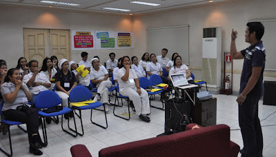 Batch 1: Sir Jerome asks questions in sign language to Fita biscuit employees.