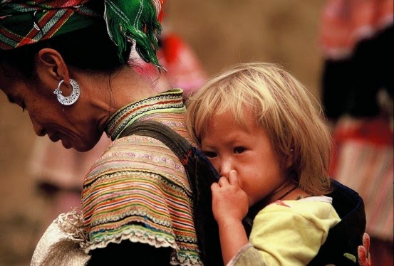 A Hmong woman with, incredibly enough, a blond baby. When I worked with the Hmong, they told me that blond and blue-eyed babies were sometimes born to Hmong women, a legacy of their origin in the Tarim Basin long ago.