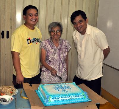 Sir Ervin Ruiz Reyes, Ma'am Remedios Esposa and Sir Jojo Esposa Jr. cuts the Anniversary Cake.