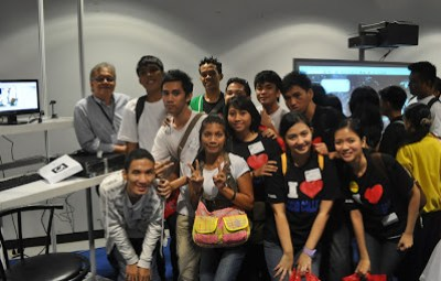 Students pose with Mr. Salvador Lastrilla, COMDDAP Vice President and exhibitor.