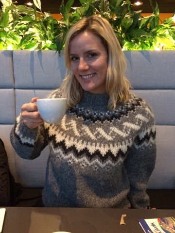 Kate drinking coffee and showing off her Icelandic jumper