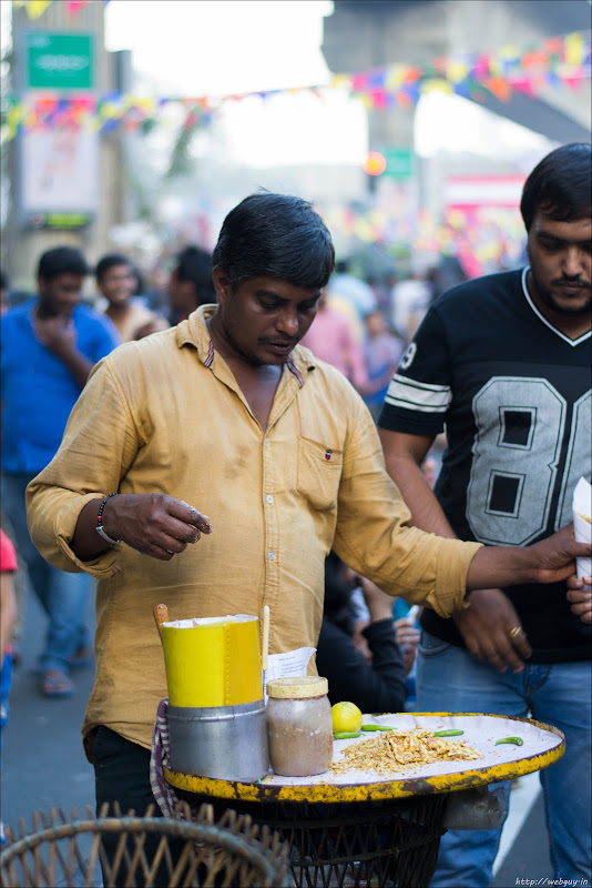 A street-hawker during Open Streets, MG Road