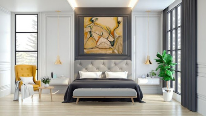 Canvas artwork hangs above bed frame