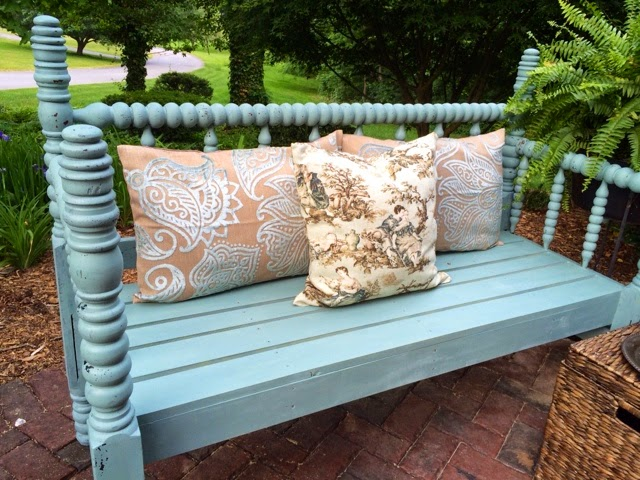 An old bed frame transformed into a bench from A Junkchick Life