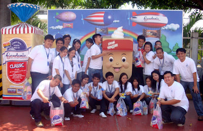 February 25: Students pose behind famous Gardenia product.