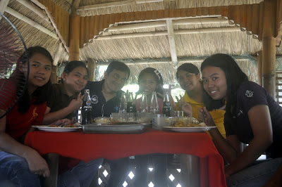 "Students take their lunch inside ""Bahay Kubo""."