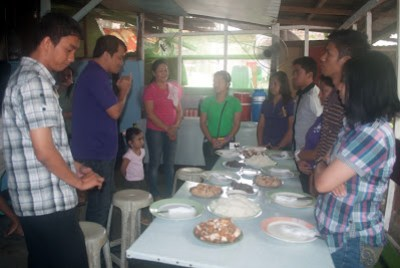 Sir Jojo leads prayer for food at Marvin Felomina's Residence in San Jose Del Monte, Bulacan