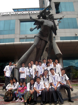 March 12: Students pose behind the GMA Network Center statue and 17-storey building.