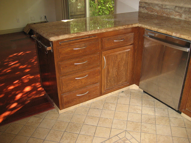 Kitchen - Stainless steel dishwasher with den in the back.
