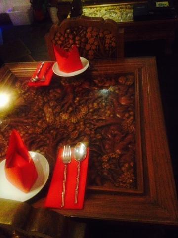 Kinkao Thai Restaurant has authentic intricate wooden decor