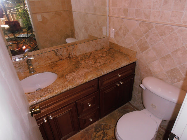 Guest Bathroom on first floor - granite countertop and travertine tiles on floors and walls.