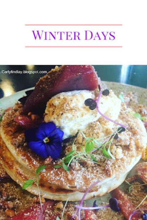 Text: winter days. Image: pancake stack with poached pear, ricotta and purple flowers.