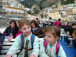 The ferry sways hard, and Lily listens to Emma for reassurance.