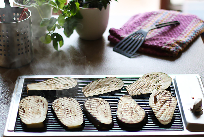 Grill the eggplant bruschettas on a plancha.