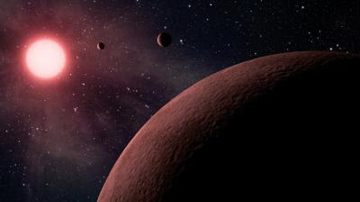 This artist's concept depicts an itsy bitsy planetary system -- so compact, in fact, that it's more like Jupiter and its moons than a star and its planets. Astronomers using data from NASA's Kepler mission and ground-based telescopes recently confirmed that the system, called KOI-961, hosts the three smallest exoplanets known so far to orbit a star other than our sun. An exoplanet is a planet that resides outside of our solar system. The star, which is located about 130 light-years away in the Cygnus constellation, is what's called a red dwarf. It's one-sixth the size of the sun, or just 70 percent bigger than Jupiter. The star is also cooler than our sun, and gives off more red light than yellow. The smallest of the three planets, called KOI-961.03, is actually located the farthest from the star, and is pictured in the foreground. This planet is about the same size as Mars, with a radius only 0.57 times that of Earth. The next planet to the upper right is KOI-961.01, which is 0.78 times the radius of Earth. The planet closest to the star is KOI-961.02, with a radius 0.73 times the Earth's. All three planets whip around the star in less than two days, with the closest planet taking less than half a day. Their close proximity to the star also means they are scorching hot, with temperatures ranging from 350 to 836 degrees Fahrenheit (176 to 447 degrees Celsius). The star's habitable zone, or the region where liquid water could exist, is located far beyond the planets. The ground-based observations contributing to these discoveries were made with the Palomar Observatory, near San Diego, Calif., and the W.M. Keck Observatory atop Mauna Kea in Hawaii.  Credit: NASA/JPL-Caltech