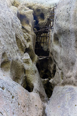 The monks prison built into the caves in the rock high up
