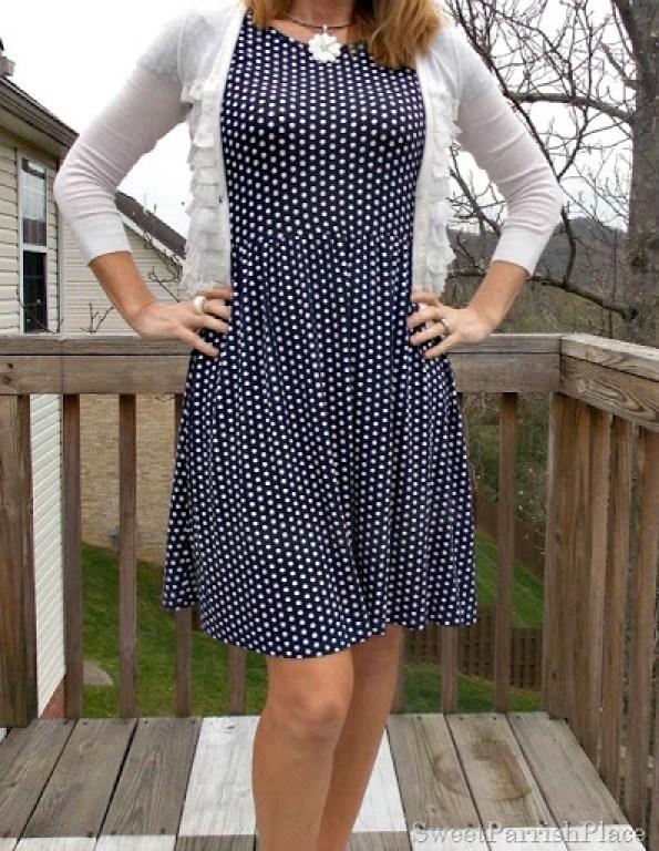 navy polka dot dress, white ruffle cardigan