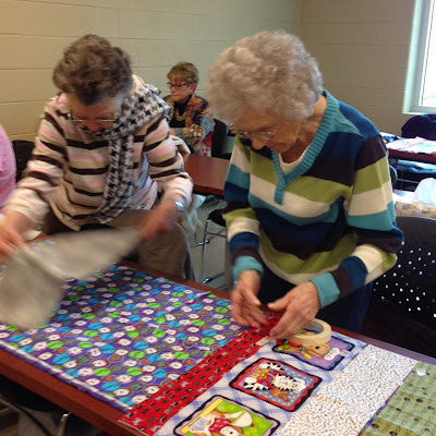 Deltha and Marie busy sorting fabric