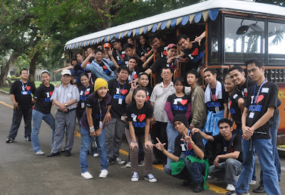 Students pose behind the Tranvia bus which was used for the whole tour.
