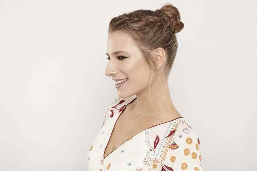 Wedding updos for continued hair: Leave some sideburns or temple tendrils chargeless to abate the look.