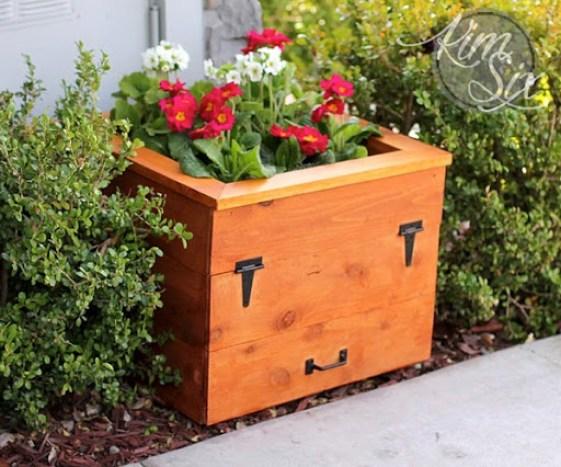 Hose Storage Hidden In Flower Planter