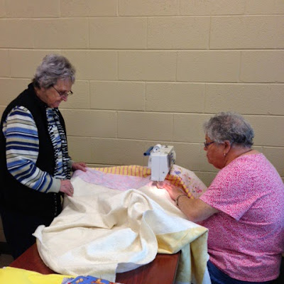 Patti and Jean busy making a quilt