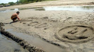 April 19: Ericson carves MCCID I-L-Y sign on sand.