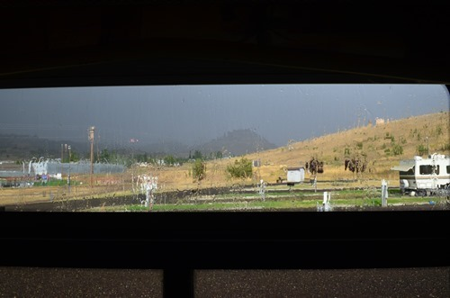 pouring rain, thunder and lightning, and sunshine at the Wheeler County Fairgrounds in Fossil