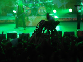 Why yes, that is a man in a wheelchair crowd surfing.