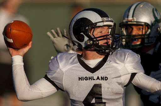 Highland quarterback Austin Peterson looks to pass, as an Olympus defender closes in