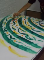 Painting the thickened dye on to the glass-topped table.
