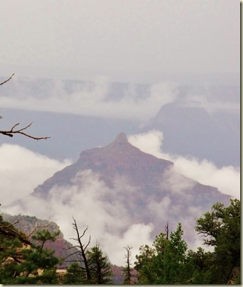 Angels Gate surrounded by clouds from Bright Angel Point trailhead North Rim Grand Canyon National Park Arizona