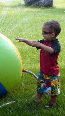 Refreshing run through the sprinkler
