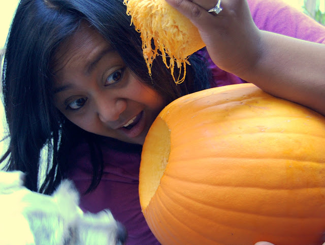 Maui and I are gutting out our pumpkin!
