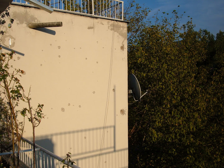 Bullet Holes from the War on Bens Apartments Outer Wall