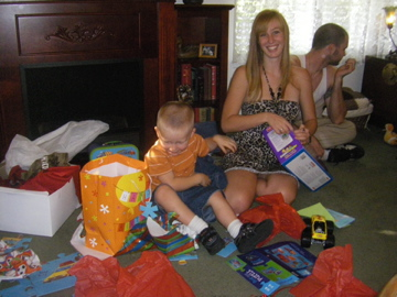 Opening presents with help from Aunt Sam.