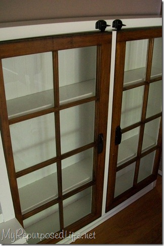repurposed windows make cabinet doors
