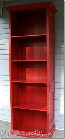 tall red bookshelf