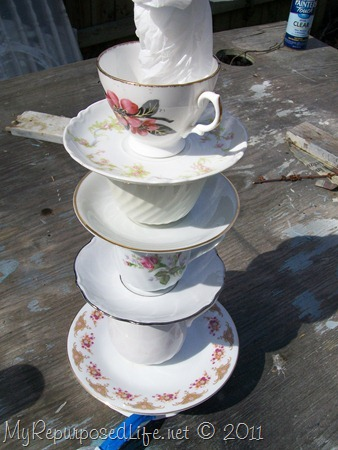 spray paint cups and saucers for teacup lamp