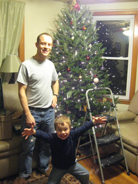 Victorious Christmas tree assemblers