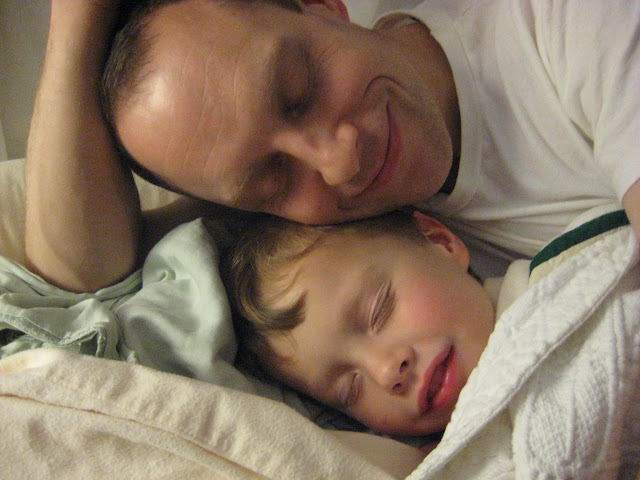 Snuggling angelically with daddy