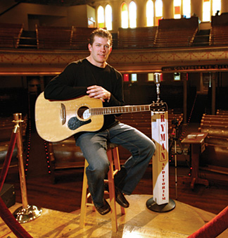 How appropriate? Strumming his guitar at the Grand Ole Opry!