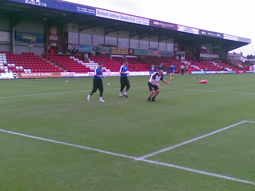 The goalkeepers warm up.