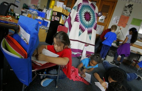 First-grader Cylas Spears worked to create an eagle quilt project last week at St. Paul's American Indian Magnet School, where language and culture courses appear to have helped raise student performance. St. Paul officials cite their Strong Schools, Strong Communities strategic plan as among the factors helping to drive progress. | Photos by Elizabeth Flores • Eflores@Startribune.Com