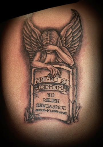 angel crying over tombstone tattoo