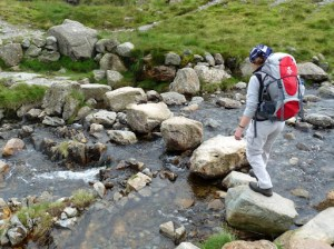 Jo crossing the stepping stones
