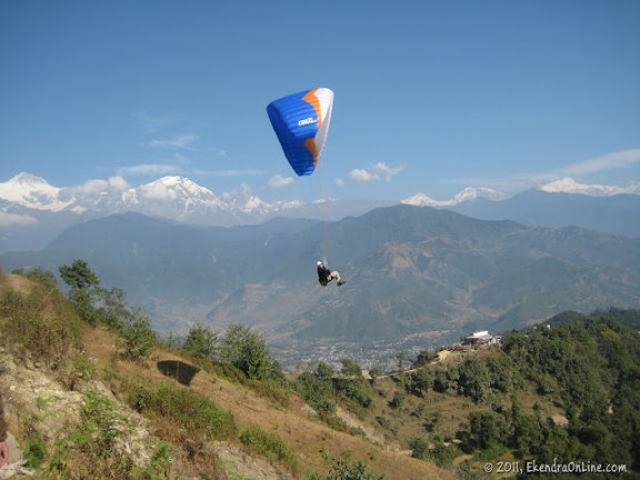 Close up: Paragliding from Sarangkot, Machhapuchhre on the background