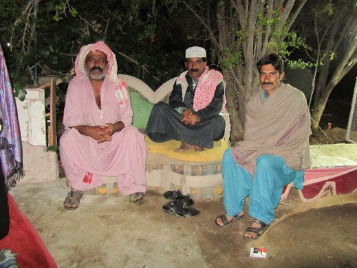 Three Bedouin men at their camp